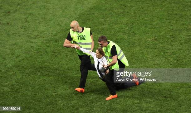 A protestor is removed from the pitch during the FIFA World Cup Final at the Luzhniki Stadium Moscow