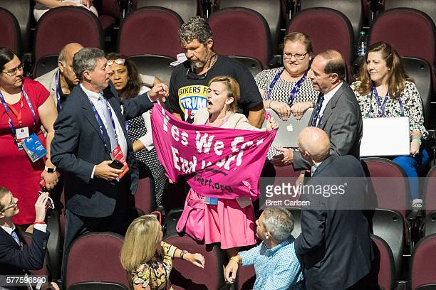 A protestor is removed from the Republican National Convention after displaying an antiwar banner on July 18 2016 at Quicken Loans Arena in Cleveland...