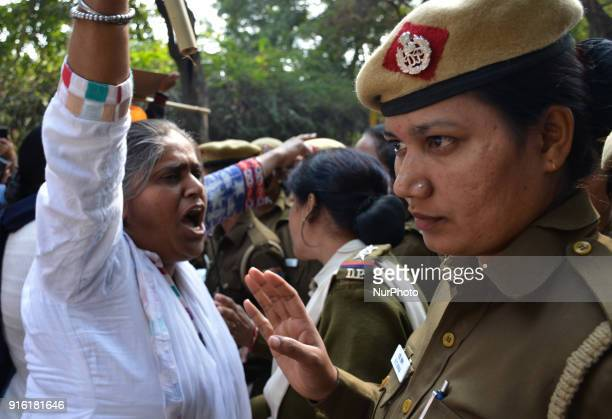 A protestor is stopped by Delhi police constables as she marches towards Delhi police barracades demanding justice for victims in the 1984 AntiSikh...