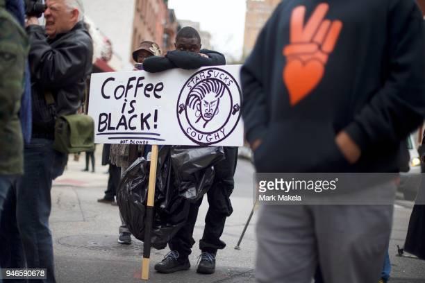 Protestor Jack Willis demonstrates outside a Starbucks on April 15 2018 in Philadelphia Pennsylvania Police arrested two black men who were waiting...