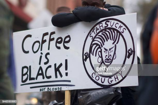 Protestor Jack Willis demonstrates outside a Starbucks on April 15 2018 in Philadelphia Pennsylvania Police arrested two black men who were waiting...