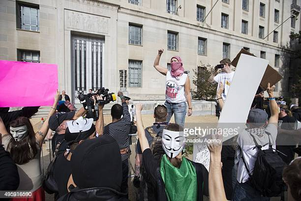 Protestor leads chants from a barrier in front of the Environmental Protection Agency during the Anonymous Million Mask March around the world in...