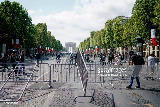 A protestor linked to the Yellow Vests movement pulls a fence in front of the Arc de Triomphe as he takes part in a demonstration on the side of the...
