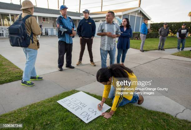 A protestor makes a sign as a small group of protesters gathered on the 1600block of West Palais Road in Anaheim on Thursday January 25 2018 to...
