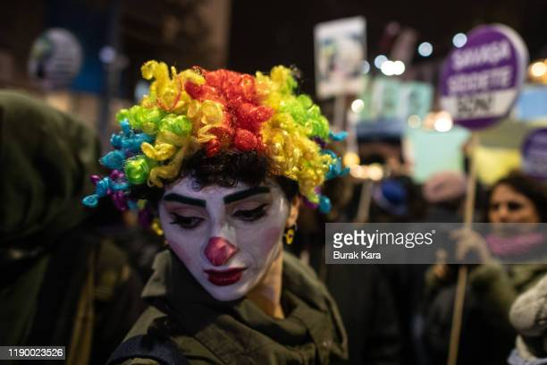 A protestor makes up as Chilean street artist Daniela Carrasco as she attends a rally marking the International Day for the Elimination of Violence...
