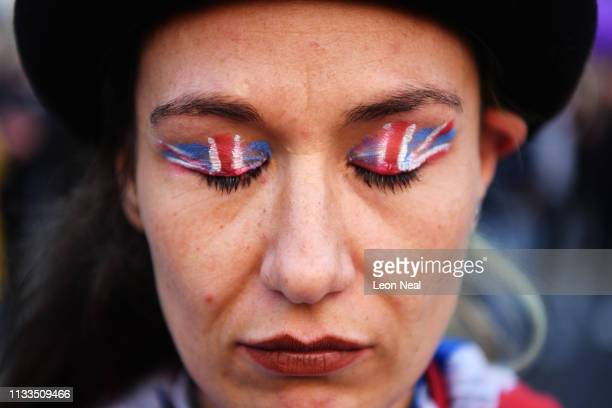 Protestor 'Million Dollar Lex' attends pro Brexit rally in Parliament Square on March 29, 2019 in London, England. Today pro-Brexit supporters...