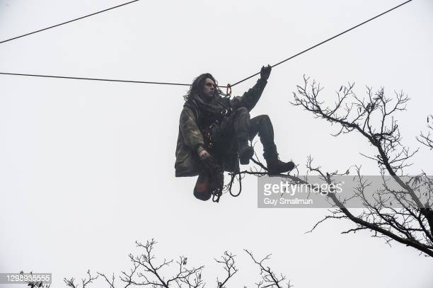Protestor on a zip wire above the camp on January 27, 2021 in London, England. The eviction came after protesters revealed to press that they'd built...