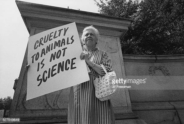 A protestor outside the American Museum of Natural History in Manhattan New York City holding a placard which reads 'Cruelty to Animals is not...