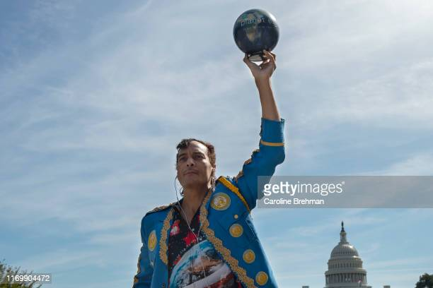 Protestor Quentin Dean holds up a small globe during the during the Global Climate Strike protests on Friday September 20 2019