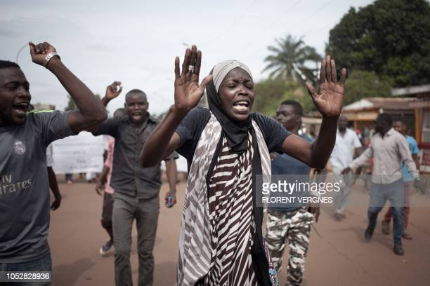 A protestor raise her arms during a demonstration against the dismissal of the speaker of the National Assembly Abdou Karim Meckassoua on October 23...