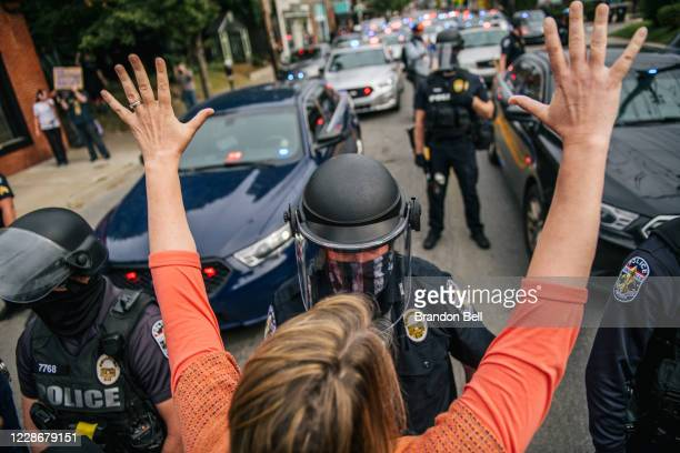 Protestor raises her hands in the air during a standoff with law enforcement on September 23, 2020 in Louisville, Kentucky. Protesters marched in the...