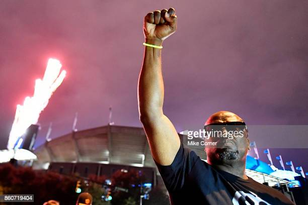 A protestor raises his fist outside the stadium before the football game between the Carolina Panthers' and the Philadelphia Eagles at Bank of...