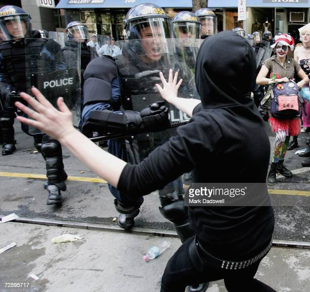 A protestor rallying against the G20 meeting is pushed back by police while attempting to cross Police barricades in Collins Street after a protest...