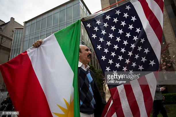 Protestor rallying against Turkish President Recep Tayyip Erdogan holds up the flags of the United States and Kurdistan outside of the Brookings...