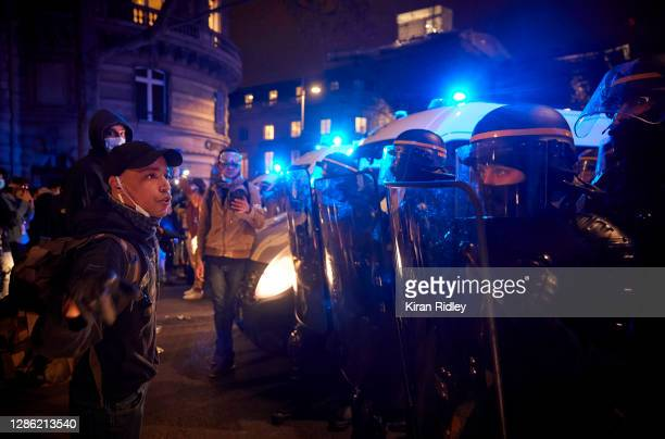 Protestor remonstrates to French Riot Police outside the National Assembly during protests against the French Government's proposed global security...