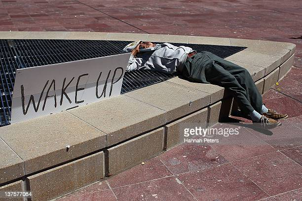 A protestor rests at Aotea Square on January 23 2012 in Auckland New Zealand More than 30 police officers were on hand this morning when three...