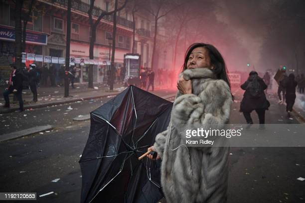 A protestor screams amidst clouds of tear gas as protestors and French Riot Police clash during a rally near Place de Republique in support of the...