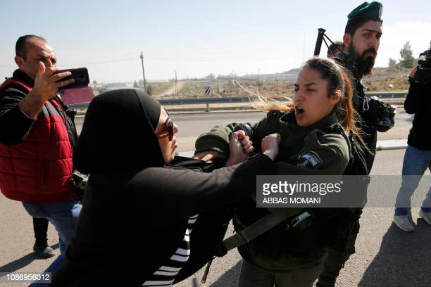 TOPSHOT A protestor scuffles with an Israeli border guard during a demonstration by Palestinian Israeli and foreign protesters against the...