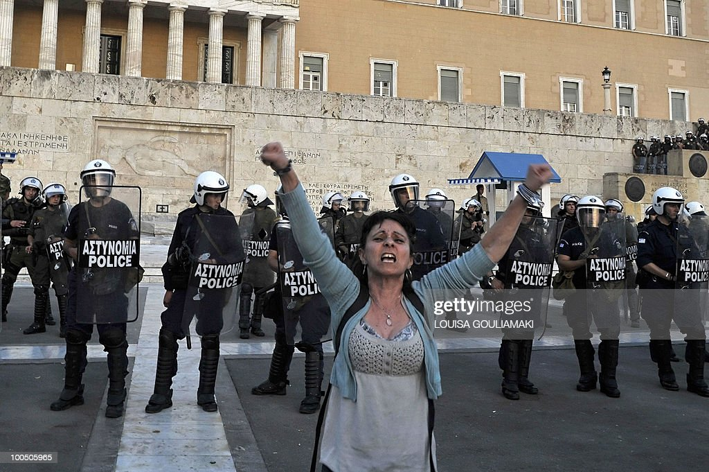 A protestor shouts in front of the Greek Parliament during a protest there on May 6, 2010. More than 10,000 people demonstrated peacefully in Greek capital as lawmakers voted on a drastic austerity package, a day after protests against cutbacks degenerated into deadly riots, police said.