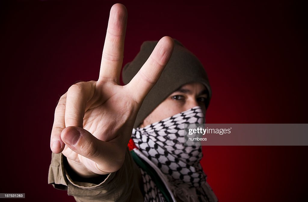 Protestor showing peace sign : Stock Photo