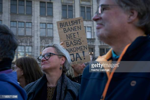 A protestor shows a placard that says no sh*t jobs during the basic income demonstration on October 26 2019 in Amsterdam Netherlands The protesters...