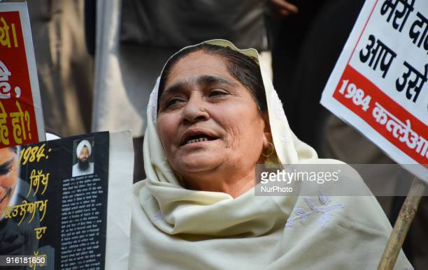 A protestor sits holding a placards demanding justice for victims in the 1984 AntiSikh riots New Delhi 9th February 2018