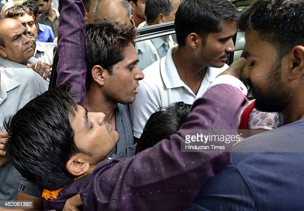 A protestor sitting on fast onto death faints during fast unto death by members of All Guest Teachers Association at Jantar Mantar in New Delhi on...