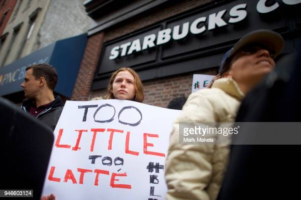 Protestor Soren Mcclay demonstrates outside a Center City Starbucks on April 15 2018 in Philadelphia Pennsylvania Police arrested two black men who...