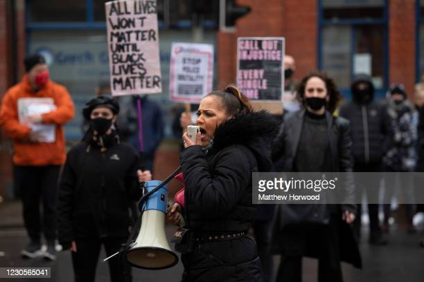Protestor speaks into a megaphone in front of Cardiff Bay police station on January 13, 2021 in Cardiff, Wales. Mohamud Mohammed Hassan was arrested...