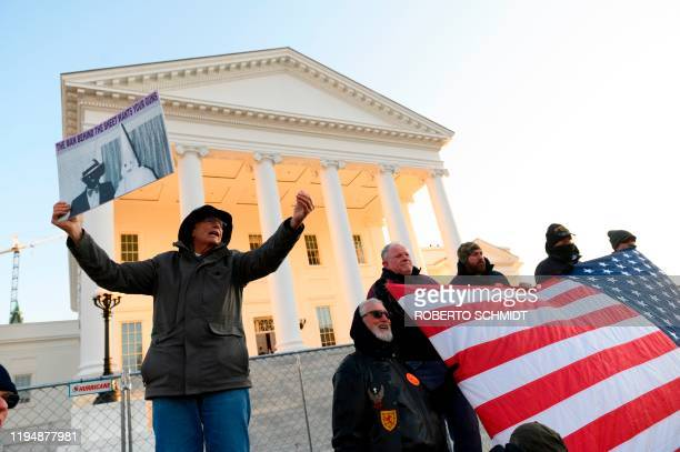 A protestor speaks to a crowd in front of the Virginia State Capitol building in Richmond Virginia on January 20 2020 Thousands of gun rights...