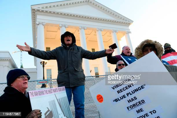 Protestor speaks to a crowd in front of the Virginia State Capitol building in Richmond, Virginia on January 20, 2020. - Thousands of gun rights...