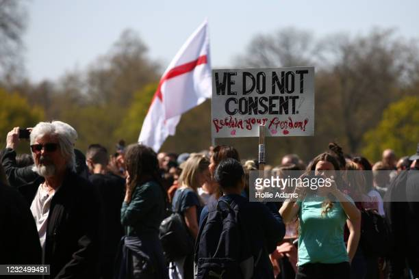 """Protestor takes a photo of a placard during a """"Unite For Freedom"""" anti-lockdown demonstration held to protest against the use of vaccine passports in..."""