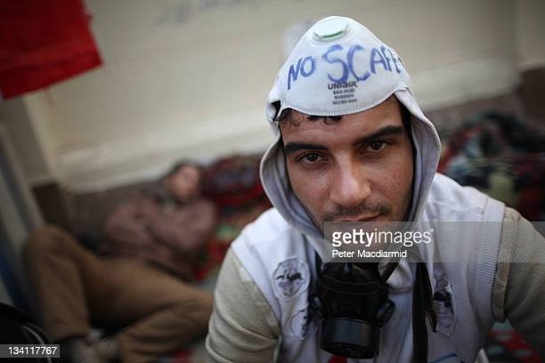 A protestor takes part in a sitin outside the cabinet office with 'No Scaf' written on his face mask which refers to the Supreme Council of Armed...
