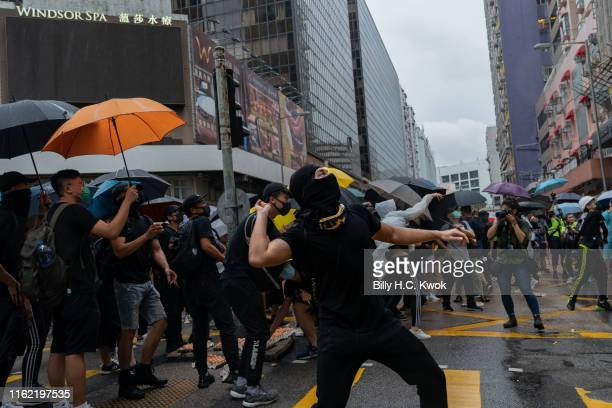 A protestor throws eggs during a march in the Hung Hom neighbourhood on August 17 2019 in Hong Kong China Prodemocracy protesters have continued...