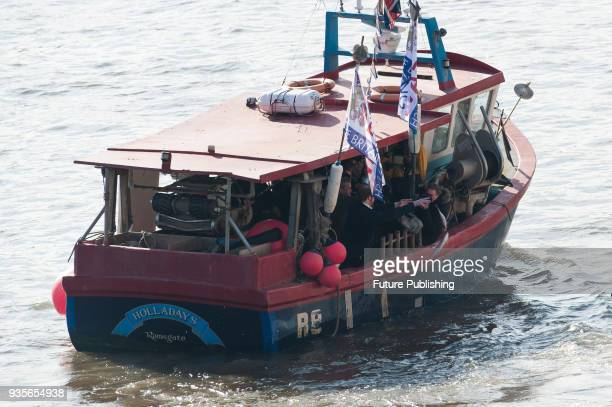 A protestor throws out fishes into the river Thames as 'Fishing for Leave' campaigners stage a protest against the impact of Brexit transition deal...