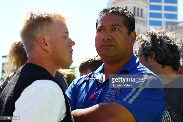 A protestor tries to move security away from his tent at Aotea Square on January 23 2012 in Auckland New Zealand More than 30 police officers were on...