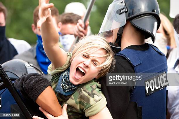 protestor trying to get through police barricade - protestor stock pictures, royalty-free photos & images
