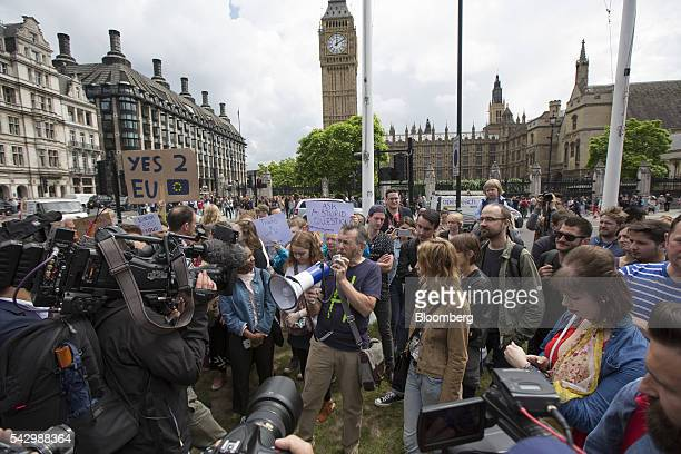 A protestor uses a megaphone to address a crowd as they gather outside The Houses of Parliament to demonstrate against the European Union referendum...