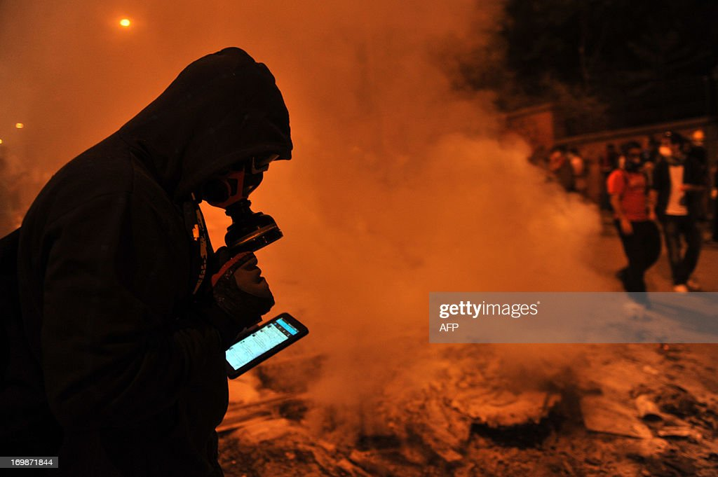 A protestor uses Facebook on mobile phone to give latestt news about the clashes near Taksim in Istanbul on June 3, 2013 during a demonstration against the demolition of the park. Turkish police on June 1 began pulling out of Istanbul's iconic Taksim Square, after a second day of violent clashes between protesters and police over a controversial development project. Thousands of demonstrators flooded the site as police lifted the barricades around the park and began withdrawing from the square. What started as an outcry against a local development project has snowballed into widespread anger against what critics say is the government's increasingly conservative and authoritarian agenda.