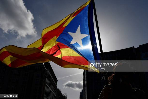 Protestor waves a Catalonia's flag during a gathering, in front of the European Union Commission, in Brussels, on February 23 and called by the...