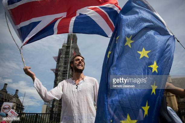 A protestor waves a Union Jack and European Union flag as they take part in the People's Vote demonstration against Brexit outside the Houses of...