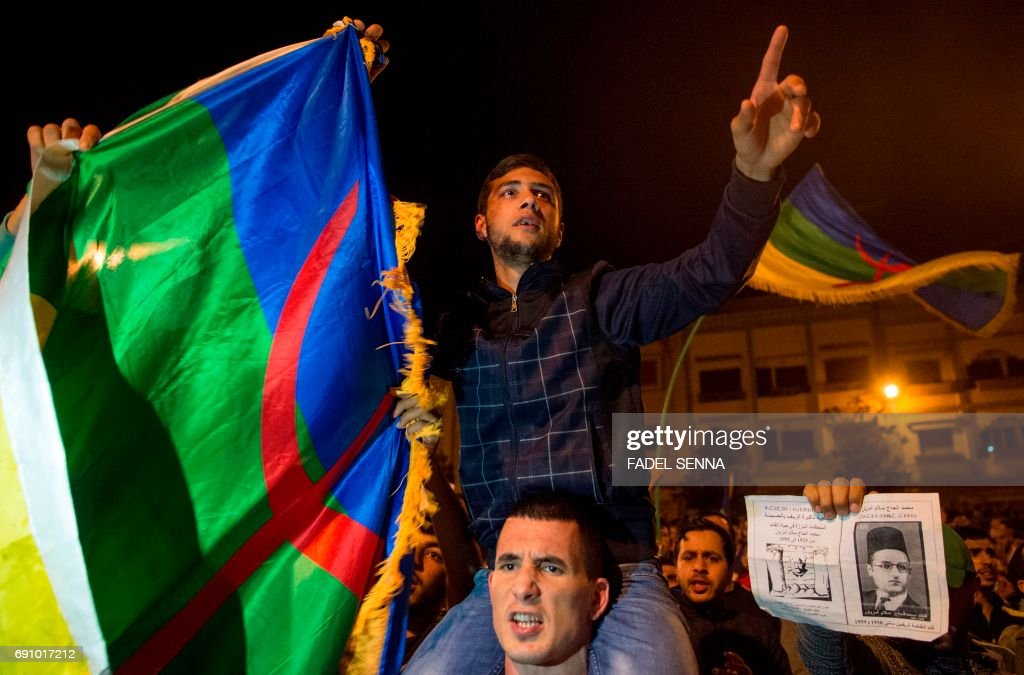 A protestor waves the Amazigh flag during a march on May 31