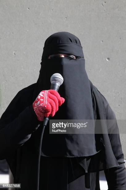 Protestor wearing a burka makes a speech about the 'evils of Islam' during a demonstration against Islam Muslims Sharia Law and M103 in downtown...