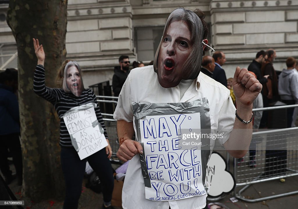 A protestor wearing a Theresa May mask takes part in small demonstration outside Downing Street on July 13, 2016 in London, England. Former Home Secretary Theresa May becomes the UK's second female Prime Minister after she was selected unopposed by Conservative MPs to be their new party leader. She is currently MP for Maidenhead.