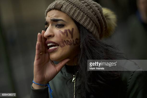 A protestor wearing 'My Choice' face paint demonstrates near the National Mall before the inauguration of Donald Trump as the 45th President of the...