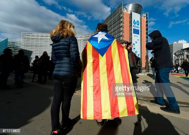 A protestor wears a Catalan proindependence Estelada flag during a demonstration of proindepence Catalan mayors to show solidarity with detained...
