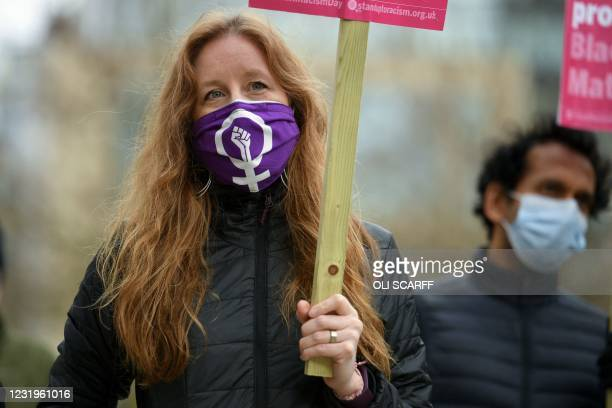 Protestor wears a face covering featuring the 'women power' symbol during a Kill The Bill protest against the Police, Crime, Sentencing and Courts...
