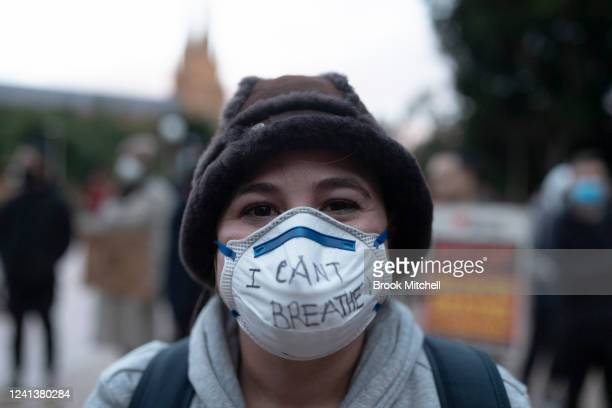"""A protestor wears a face maks with the words I can't breathe written on it in Hyde Park during a """"Black Lives Matter rally held in solidarity with US..."""