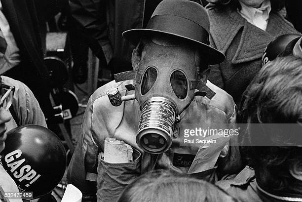 A protestor wears a gas mask and hat while participating at the first Earth Day demonstration at Daley Plaza Chicago Illinois April 22 1970