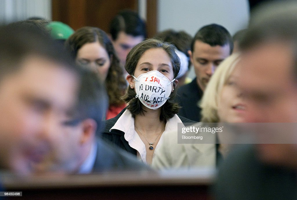 A protestor wears a mask inside a hearing on coal energy in Washington, D.C., U.S., on Wednesday, April 14, 2010. A hearing of the House Select Committee on Energy Independence was disrupted today when protestors wearing masks began yelling as Peabody Energy Corp. Chief Executive Officer Gregory Boyce testified on the coal industry. Photographer: Andrew Harrer/Bloomberg via Getty Images